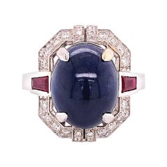 13.48Kt Natural Oval Sapphire Cabochon 0.42Kt Diamond 0.66Kt Ruby Cocktail Ring