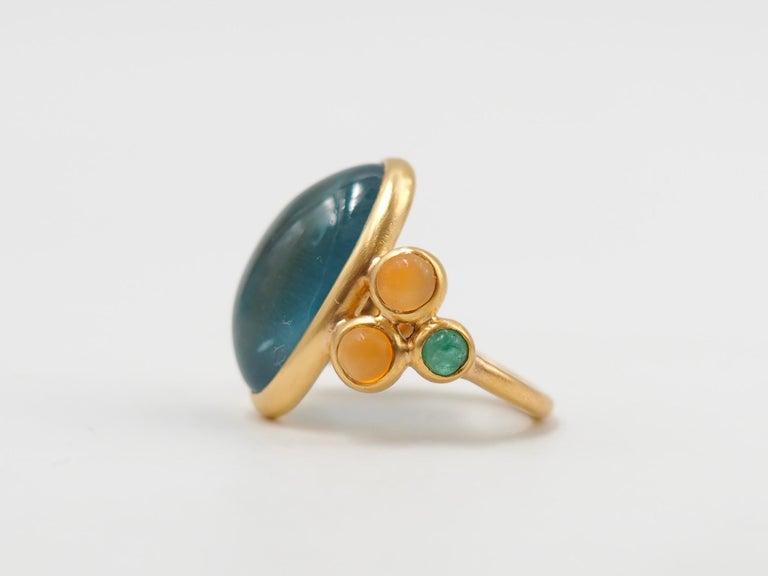 Contemporary Scrives 13.5 Carat Aquamarine Emerald Cornaline Cabochons 22 Karat Gold Ring For Sale