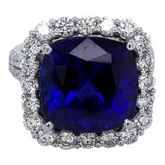 13.51 Carat Cushion Shaped Tanzanite Split Shank Pave Set Ring with Halo