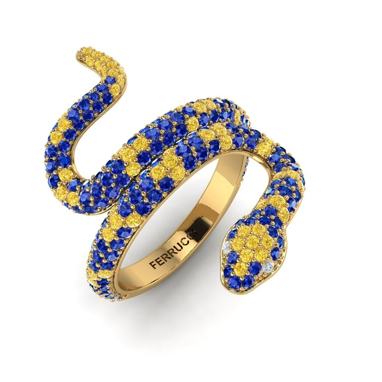 Blue Sapphires Pave' Snake 14k Yellow Gold Ring, with Yellow Sapphires, hand picked, totalling approximately 1.35 carats, made in 14k Yellow gold to help the slim design, to have more robustness, with white diamonds as eyes. Made to order in your