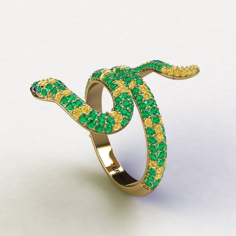 Emeralds Pave' Snake 14k Yellow Gold Ring, bright green hand picked emeralds and Yellow Sapphires and Blue Sapphires, totalling approximately 1.35 carats, made in 14k Yellow gold to help the slim design, to have more robustness. Made to order in