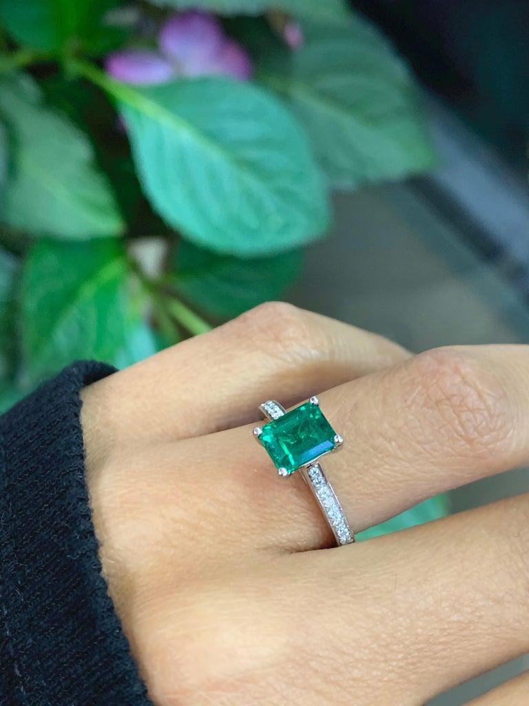1.36 Carat Emerald Cut Emerald and Diamond Platinum Engagement Ring For Sale 5