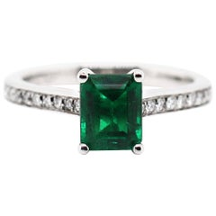 1.36 Carat Emerald Cut Emerald and Diamond Platinum Engagement Ring