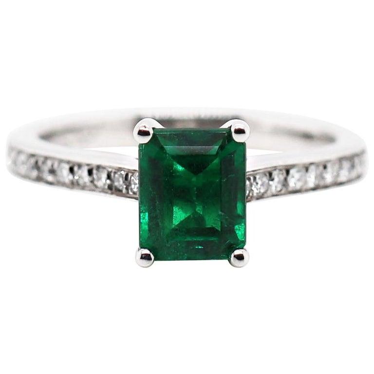 1.36 Carat Emerald Cut Emerald and Diamond Platinum Engagement Ring For Sale
