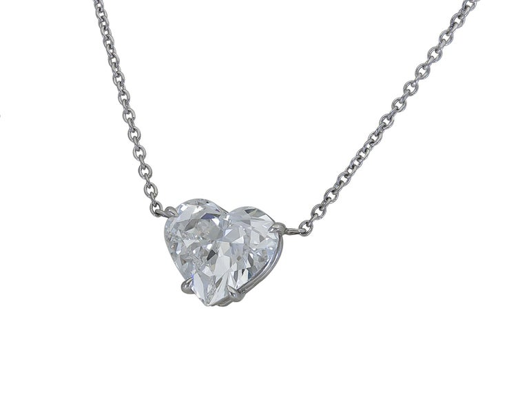 A classic and timeless pendant necklace showcasing a single heart shape diamond center, set in an 18k white gold mounting. Pendant suspended on a 15.5 inch white gold chain. Diamond weighs 1.36 carats and is F color, VS1 clarity. Pendant Dimensions: