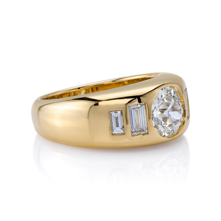 1.36ctw M/SI1 GIA certified old European cut diamond with 0.57ctw Baguette cut accent diamonds set in a handcrafted 18K yellow gold domed mounting.  Ring is a size 6 and can be sized to fit.
