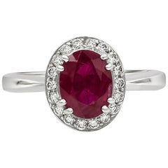 1.36 Carat Oval Cut Ruby and Diamond Halo Engagement Ring