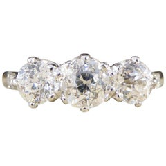 1.36 Carat Total Diamond Three-Stone Ring with Diamond Shoulders in Platinum