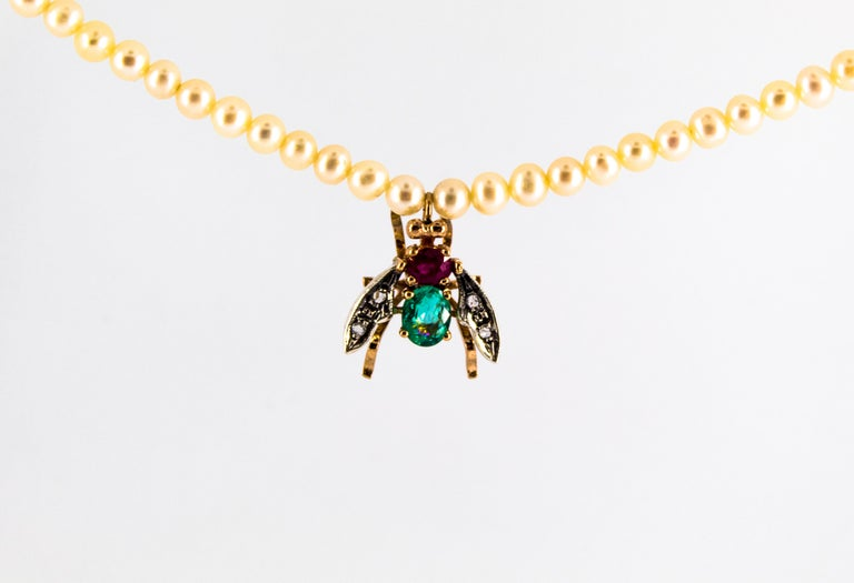 The Fly Pendant is made of 9K Yellow Gold and Sterling Silver but it is available also in 14K and 18K Yellow Gold. The Fly Pendant has 0.08 Carats of White Rose Cut Diamonds. The Owl Pendant has 1.30 Carats of Emerald and Ruby but it is available