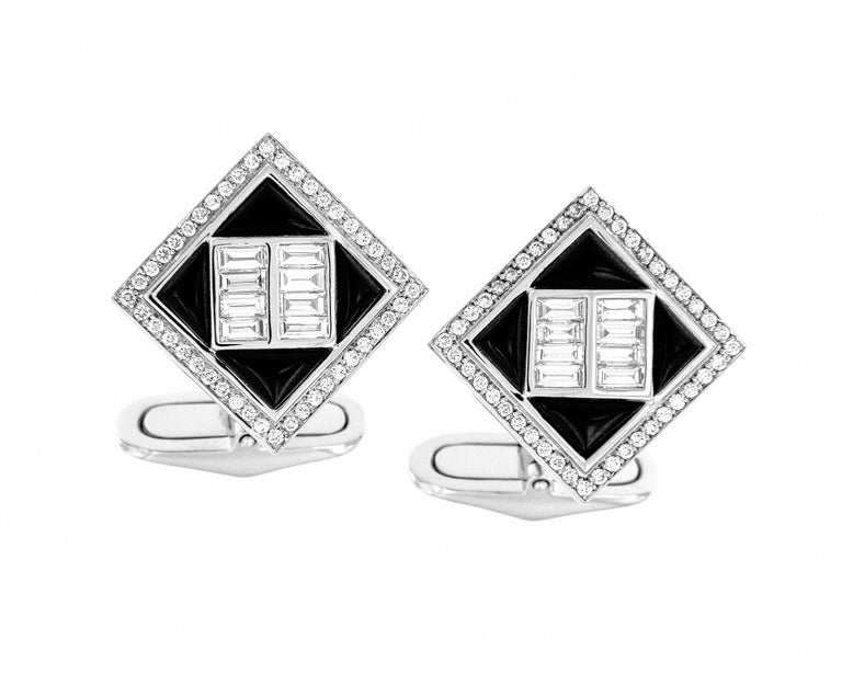 These 18k white gold cufflinks are the perfect accesorry to amplify a mans power. The diamond baguettes are beauifully set with black onyx and pave'd diamonds. This is a true gentlemen's statement piece.   18K White Gold Diamonds - 1.14 cts Black