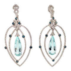 14 Carat Aquamarine/ light blue color/ 18kw Designer pear Diamond Earring