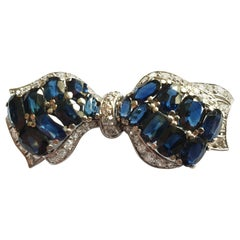 14 Carat Bow Brooch with Sapphires and Diamonds