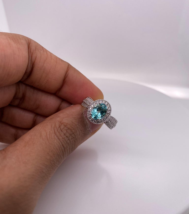Oval Cut 1.4 Carat Paraiba and White Diamond Ring in 18 Karat White Gold For Sale