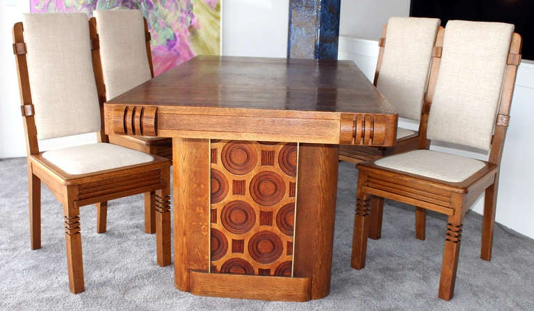 High quality chairs designed by Charles Dudouyt. Set of 14 which can be divided. Architectural and geometrical moldings. Refined and sophisticated details. Extremely modern conception for the period with rigorous lines. Quality golden oak.