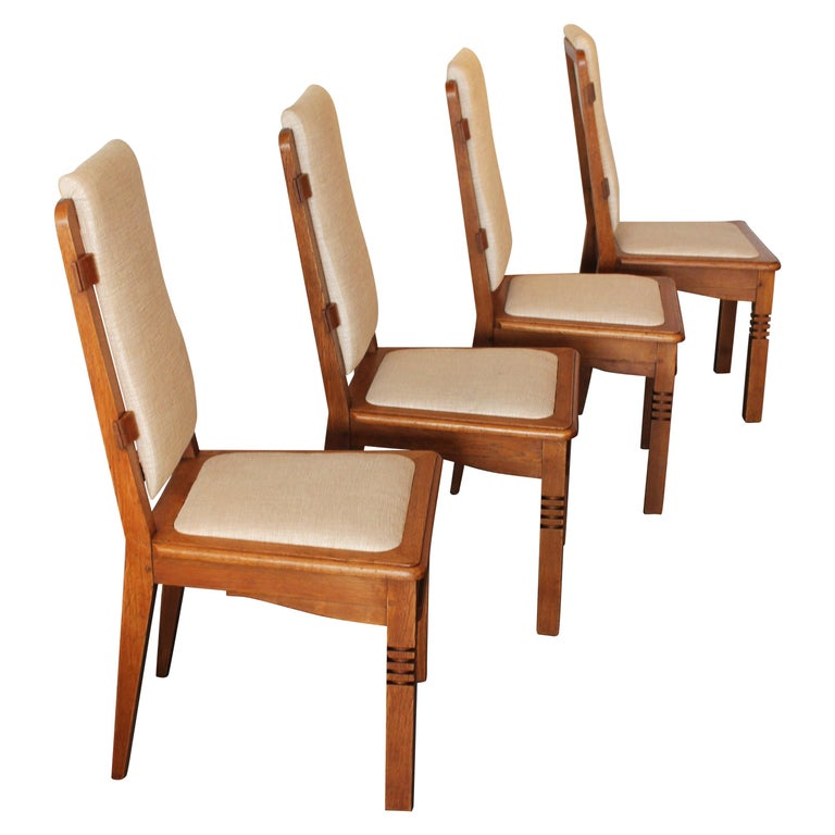 14 Chairs in Oak Designed by Charles Dudouyt For Sale