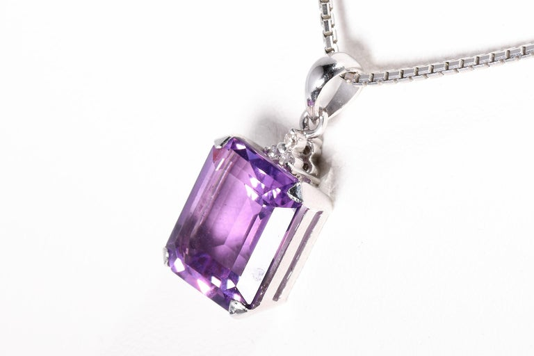 14 k white gold hallmarked with fineness 585 9,5 ct Amethyst 0,05 ct diamonds length ca. 22 mm width ca 12 mm weight 3,5 Grams