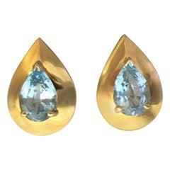 14 Karat Blue Topaz Pear Shape Earrings