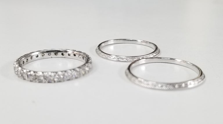 14k white gold diamond eternity ring with 28 round full cut diamonds of very fine quality weighing .70pts. with 2 14k white gold hand engraved beveled rings.  3 separate rings to mix and match. size 6
