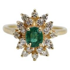 14 Karat Emerald and Diamond Cluster Ring