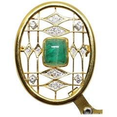 14 Karat Emerald and Diamond Pin Containing 1 Cushion Cut Cabochon Emerald