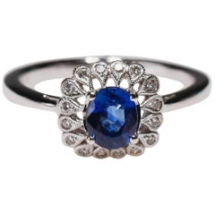 14 Karat White Gold 0.87 Carat Oval Blue Sapphire Diamond Floral Halo Ring