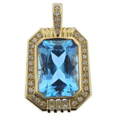 14 Karat Gold 20 Carat Blue Topaz VS Diamond Necklace Pendant
