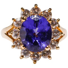 14 Karat Gold 3.3 Carat Oval Cut Tanzanite 1.1 Carat Diamond Flower Bridal Ring