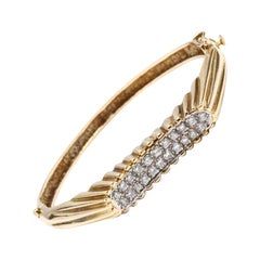14 Karat Gold and Diamond Bangle Bracelet, circa 1960s-1970s