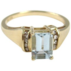 14 Karat Gold Aquamarine and Diamond Emerald Cut Ring