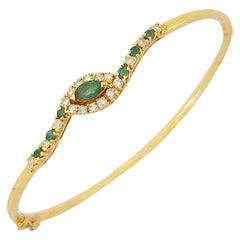 14 Karat Gold Bangle Bracelet with.85 Carat Emeralds and .33 Carat Diamonds