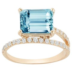 14 Karat Gold Blue Topaz Point of Focus Ring