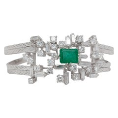 14 Karat Gold Bracelet with Emerald and Baguette and Brilliant Cut Diamonds