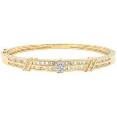 14 Karat Gold Channel Set Diamonds Bangle with Bazel Set Center Stone 1.95 Carat