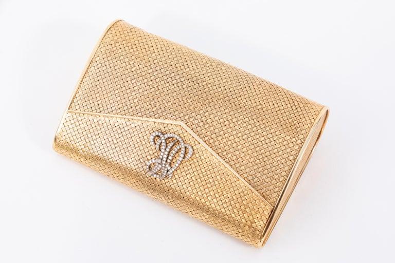 14-karat gold clutch purse with diamonds. Woven 14-karat gold. Believed to be of Italian origin. Initials are