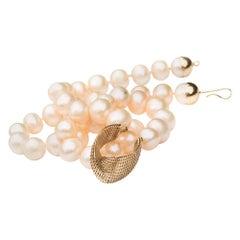 14 Karat Gold Cream Freshwater Pearls, Net Mobius Center Piece