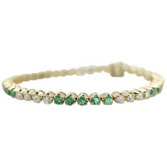14 Karat Gold Custom Made Bracelet with Very Clean Emeralds and Round Diamonds