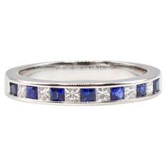 14 Karat Gold Diamond and Blue Sapphire Channel Set Diamond Wedding Band Ring