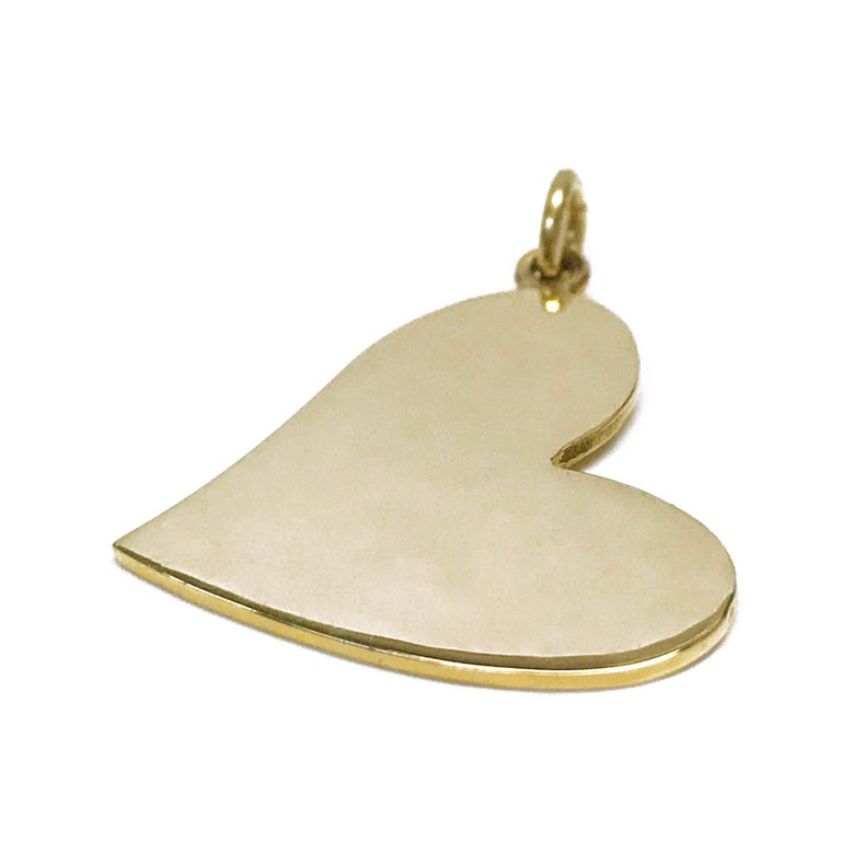 14 Karat Gold Heart-Shaped Pendant. A simple yet elegant design in a smooth finish all around. The total gold weight of the pendant is 2.18 grams.