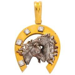 14 Karat Gold Horseshoe Pendant with 14 Karat White Gold Horses and Diamonds