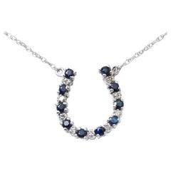 14 Karat Gold Ladies Horseshoe Pendant Necklace with Diamonds and Sapphires