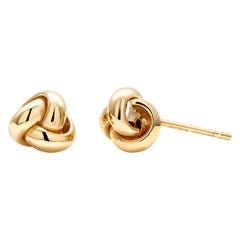 Fourteen Karats Yellow Gold Love Knot Stud Earrings Measuring 0.30 Inch