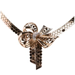 14 Karat Gold Retro Necklace Incorporating a Stylized Bow Inset with Diamonds