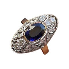 14 Karat Gold Ring with 26 Diamonds and Sapphire