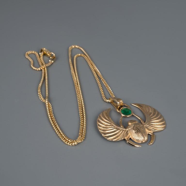 Art Deco 14 Karat Gold Winged Scarab Beetle Pendant Necklace Natural Certified Emerald For Sale