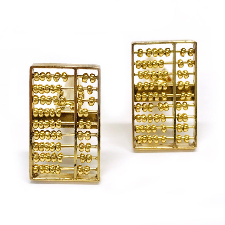 14 Karat White Gold Rectangular Abacus Cufflinks. Four round single-cut diamonds are bead-set on each cufflink. The cufflinks have a dual post and bullet backing. Stamped on the back of each cufflink is 14K. The total weight of the cufflinks is 6.4