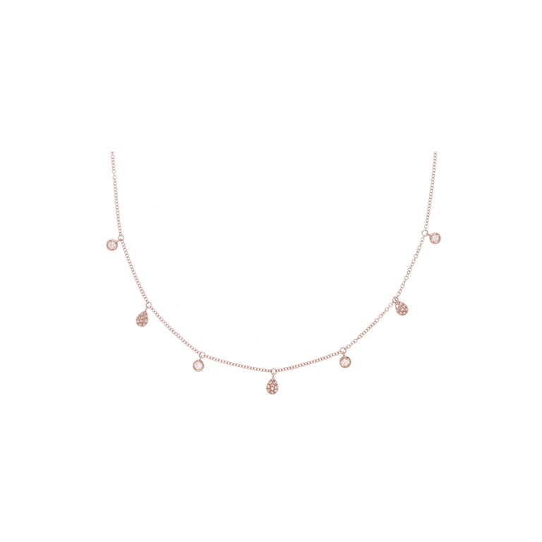 This Round Diamond and Pear-shape Pave Drop Chain Pendant is made in 14 karat Rose Gold, set with natural, colourless diamonds. With a total diamond carat weight (approximate) of 0.217 carat, The Diamonds are H colour, Si clarity. This pendant is