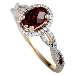 14 Karat Rose Gold Diamond and Garnet Oval Ring