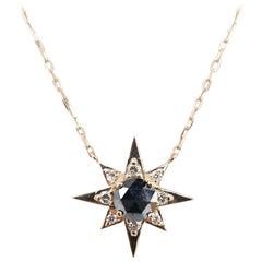 14 Karat Rose Gold Diamond Star Burst with Black and White Diamonds