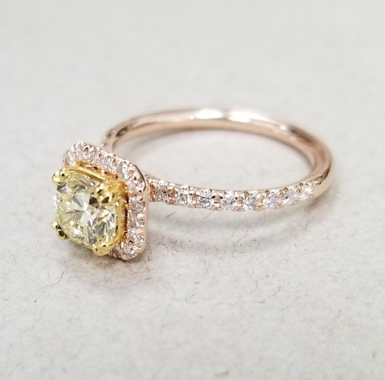 14k rose gold EGL .93pts. natural light yellow and VS1 clarity surrounded by 36 round full cut diamond of nice quality weighing .35pts. set in a halo ring.