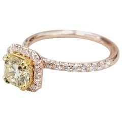 14 Karat Rose Gold EGL .93pts, Natural Light Yellow Diamond Halo Ring
